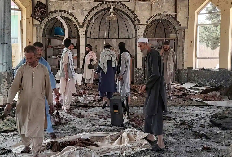 Bomb Blast : Bomb blast inside mosque in Afghanistan, 50 killed, people praying in mosque at the time of blast, piles of dead bodies laid in mosque